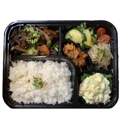 KOREAN STYLE BENTO (White Rice, Bulgogi Soy-Marinated Rib Eye, Kimchi, Potato Salad, Zucchini Salad,